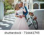 bride and groom with a bicycle... | Shutterstock . vector #716661745