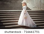 a beautiful young bride in a... | Shutterstock . vector #716661751