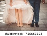 legs in the shoes of newlyweds... | Shutterstock . vector #716661925