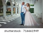 a lovely couple of newlyweds.... | Shutterstock . vector #716661949