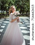 lovely young bride in wedding... | Shutterstock . vector #716662615