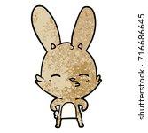 curious bunny cartoon   Shutterstock .eps vector #716686645