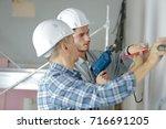 professional workmen working on ...   Shutterstock . vector #716691205