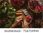 chop a chili in a thai kitchen | Shutterstock . vector #716714944