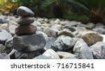 the stone pile in the garden. | Shutterstock . vector #716715841