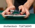 Small photo of Poker player shuffling cards, close-up