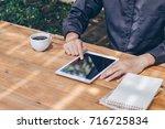 close up businessman using... | Shutterstock . vector #716725834