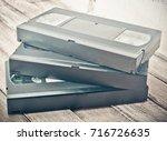 three video cassettes lie one... | Shutterstock . vector #716726635