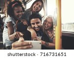 diverse group of young friends... | Shutterstock . vector #716731651