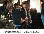 focused young businessman... | Shutterstock . vector #716731657