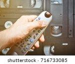 close up tv remote control in... | Shutterstock . vector #716733085
