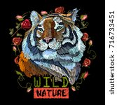 embroidery tiger. portrait of... | Shutterstock .eps vector #716733451
