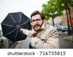 bearded man in eyeglasses and... | Shutterstock . vector #716735815