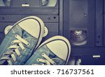 youth sneakers lie on video... | Shutterstock . vector #716737561