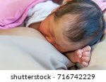 breastfeeding newborn in... | Shutterstock . vector #716742229