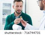 Sick Patient Taking Pill Bottle ...