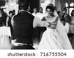 Bride And Groom Hold Each Othe...