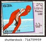 laos   circa 1988  a stamp... | Shutterstock . vector #716759959