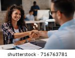 young woman signing contracts... | Shutterstock . vector #716763781