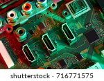electronic circuit board close... | Shutterstock . vector #716771575