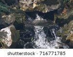Cascade Waterfall Among Rocks...