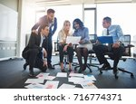 diverse group of focused... | Shutterstock . vector #716774371