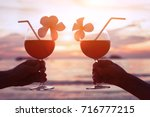 couple drinking cocktails on... | Shutterstock . vector #716777215