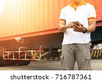 shipper man handling smart... | Shutterstock . vector #716787361