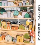 wooden toy houses at the fair | Shutterstock . vector #716791591