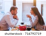 dating  man and woman laughing... | Shutterstock . vector #716792719