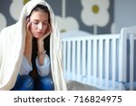 young tired woman sitting on... | Shutterstock . vector #716824975