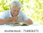 man reading interesting book   Shutterstock . vector #716826271