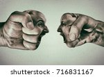 two fists with a male and... | Shutterstock . vector #716831167