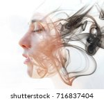 Double Exposure Portrait Of A...