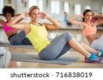 blond female in fitness group... | Shutterstock . vector #716838019