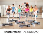 fitness training in group at gym | Shutterstock . vector #716838097