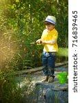 little boy is engaged in... | Shutterstock . vector #716839465