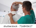 man having chiropractic back... | Shutterstock . vector #716843617