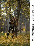 couple in the autumn forest on... | Shutterstock . vector #716844385