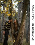 couple in the autumn forest on... | Shutterstock . vector #716844409