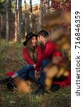 couple in the autumn forest on... | Shutterstock . vector #716846359