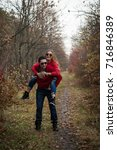 couple in the autumn forest on... | Shutterstock . vector #716846389