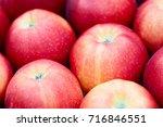 close up of a dark red apple... | Shutterstock . vector #716846551