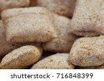 many closeup hard bread chucks... | Shutterstock . vector #716848399