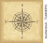 hand drawn compass. old paper... | Shutterstock .eps vector #716848591