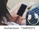 woman using smart phone with... | Shutterstock . vector #716853271