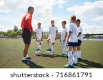 portrait of junior football... | Shutterstock . vector #716861791