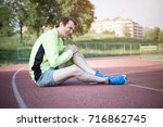 running sportsman feeling pain... | Shutterstock . vector #716862745