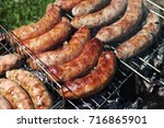 grilled sausages. closeup of... | Shutterstock . vector #716865901