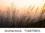 sunset scene on high mountain.... | Shutterstock . vector #716870851